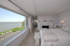 The home boasts six bedrooms, many of which have wall-to-wall windows with water views.