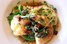 Lucia Watson's signature dish: roasted chicken with wild rice-leek pudding, sugar snaps, & thyme-mushroom demi