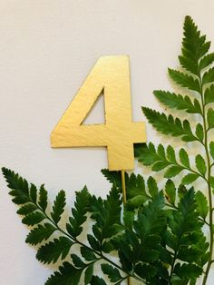 Handmade gold table number. Created by Christina Gates: www.createdbychrista.com/weddings. #createdbychrista #wedding #gold #greenery #fern #garden #party #table #number #paint #painted #modern #timeless #handmade #handpainted #original #custom #personalize #design #event #specialoccasion #theme #artwork #creative #unique