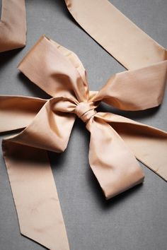 We love these supple silk sashes from Hitherto. Personalize your dress by  adding a brooch cf768f8b2e28