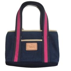 """The SAK Bag Navy Blue Pink Purse Cute The SAK Bag Navy Blue Pink Purse for spring, summer & fall Zipper closure 2 inside pockets 1 inside zip picket Credit card holders Outside pocket beige trim Green & Navy butterfly lining 11"""" x 3"""" x 7"""" with 7.5"""" strap drop Excellent Condition 🚫Trades The Sak Bags"""