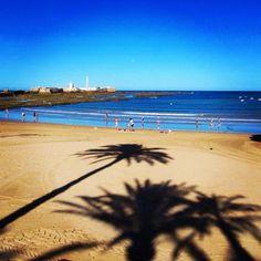Long shadows in Cadiz, Spain. Photo courtesy of traveltimestwo on Instagram.