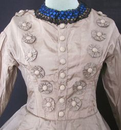 1860's Silk day dress with nice rosette trimming, bodice closeup