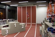 Creative display for a children's shoe store. I love the track going up the wall