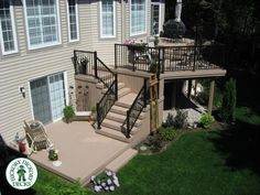 Here is a very interesting design for both a high deck and a lower deck. This one is built in Ottawa using Azek decking and black aluminum rail.