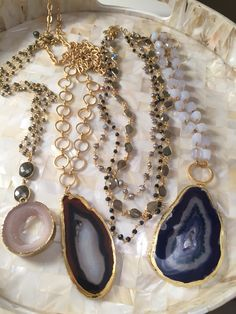 Assorted gemstones mixed with gold. Agates, quartz, labradorite, spinel, pyrite, fresh water pearls.  Email lisajilljewelry@gmail.com for more info