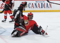 OTTAWA, ON - DECEMBER Mike McKenna of the Ottawa Senators stacks the pads to make a save in overtime against the Boston Bruins at Canadian Tire Centre on December 2018 in Ottawa, Ontario, Canada. (Photo by Andre Ringuette/NHLI via Getty Images) Ottawa Ontario, Nhl Games, Canadian Tire, Boston Bruins, Golf Bags, Hockey, Centre, December, Canada