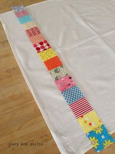 Well, hello! Today I will share a simple (and fun) little tutorial on how to make a patchwork dish towel. The strip of patchwork is a perf...