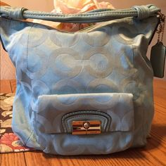 Light blue Coach Kristen bag Light blue Coach Kristen bag in excellent condition! I have used this bag twice. This bag will hold lots of stuff! Coach Bags Shoulder Bags