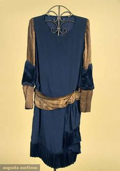 1927 Navy ribbed knit silk trousseau dress, sleeve & hip sash gold lame in wave pattern, hem, sleeve insert & hem sash ends trimmed w/ knife pleated navy silk;