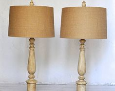 Set of Two TABLE LAMPS with BURLAP LAMPSHADES for sale:  Full of style and flair, embrace your inner chic designer and set your home apart with this unique set of lamps.  Style: Cottage Chic Color: Creme Height: 32 Burlap Lampshades: Included  *READY TO SHIP* (Shipped within 2 business days)  *FEATURES & QUALITY*  I take pride in the craftsmanship and quality of each of my pieces. My attention to detail in design and materials is of utmost importance to me. I consider each of my pieces a ...