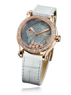 Chopard Happy Fish timepiece with sapphires, diamonds, luminescent fish in textured mother-of-pearl, and 18-karat rose gold case.