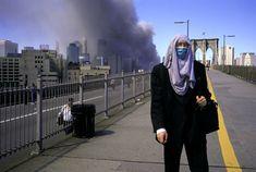 Alex Webb - USA. New York City. September 11, 2001. Leaving Manhattan on the Brooklyn Bridge.