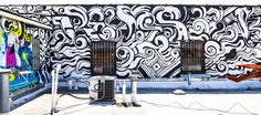 Wall collaboration from artists Reyes, Pose, and Omens.
