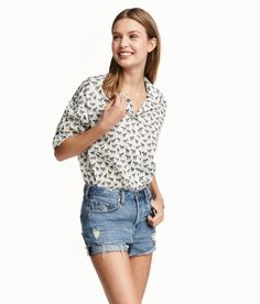 Check this out! CONSCIOUS. Long-sleeved shirt in airy, woven organic cotton fabric with a printed pattern, pearlescent buttons, and rounded hem. - Visit hm.com to see more.