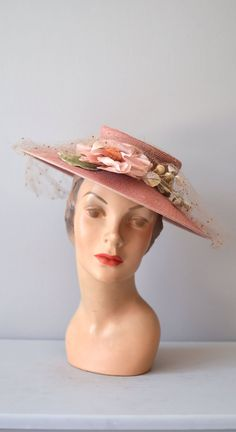 Beautiful 1940s dusty peachy-pink hat with veiling and millinery flowers. #vintage #1940s #spring #summer #hats