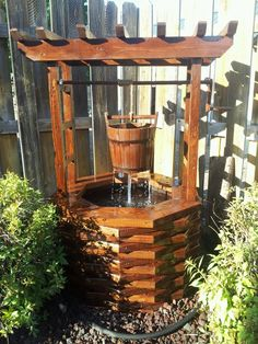 Diy wishing well - would love this for the backyard - could double as a bird water feeder/bird bath!
