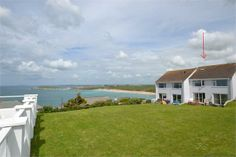 3 bedroom house overlooking Fistral Beach with a shared swimming pool.  Could be a letting opportunity