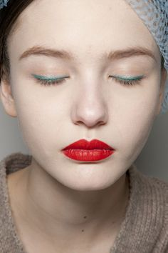 Red lips and pale blue eyeliner at Jil Sander Fall 2011 - Now, where to find eggshell eyeliner (off of a runway)?