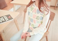 I really like this multi-patterned sweater with the pastel jeans.
