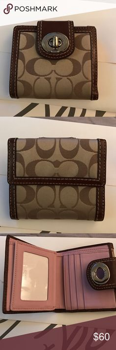 Authentic Coach Wallet Excellent Condition/Barely used Coach Wallet. Fabric/Leather wallet!! In picture three you will see a tiny mark. Fabric has no stains! Coach Bags Wallets