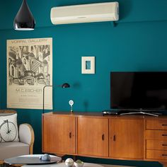 dark teal wall, deep blue green wall painting, living room green wall • the Round Button blog