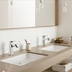 Hansgrohe Metris Classic single lever faucets on double sinks.