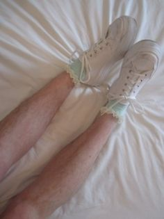 Hairy legs, frilly socks.
