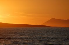 Corfu Sunset on de beach in San Stephanos, in Agios Stefanos, Peloponnese Western Greece, Ionian Island_ Greece