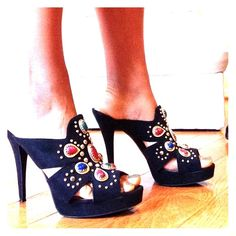 Carlos Santana Heels Stand out in the crowd with these unique shoes! Women's size 10. Black with gold studs; red, blue and green stones. Very comfortable with a small platform. Only worn ONE time Carlos Santana Shoes Heels