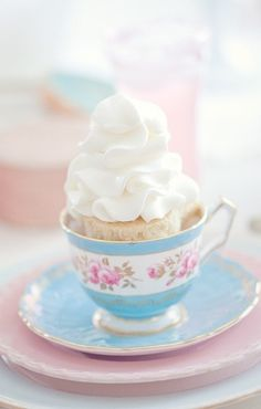 Cupcake with lots of whipped cream in a teacup