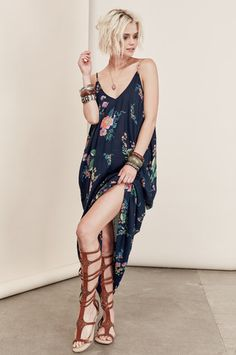 Bohemian Dresses & festival street style: Sleeveless navy blue floral print Maxi dress with pockets. Front view