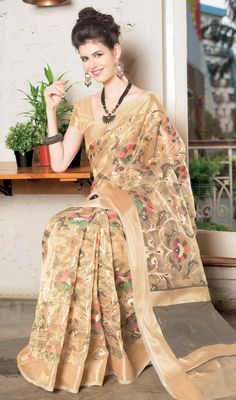 Dazzle like million stars on your special day wearing this cream color shade embroidered jute sari. The enticing lace and resham work a considerable element of this attire. #floralprintsaree #floralworksaris #newdesigntrendysari