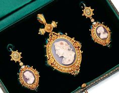 Archeological Revival gold, hardstone cameo and enamel pendant-locked and earrings, c. 1870.