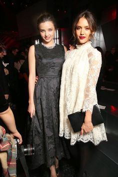 Miranda Kerr and Jessica Alba pose together at the H&M autumn/winter 2014 fashion show during Paris Fashion Week on Feb. 26, 2014.