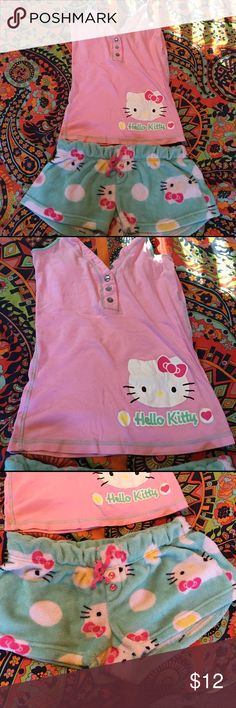 Hello Kitty Pajama Set Adorable Hello Kitty pajama set. T-strap top and fuzzy, soft, cozy shorts. This item hasn't been worn, and it's been in a drawer. It's an XL, but fits like a medium. Hello Kitty Intimates & Sleepwear Pajamas