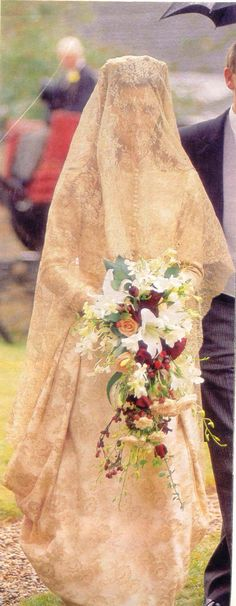 Charles Spencer's First wife Victoria arrives at Great Abington church near Althorp, in what must be thickest veil a bride ever wore outside the Middle East.