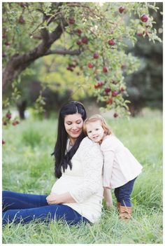 apple orchard, family photograpy, family poses, family of three, maternity pictures, mommy daughter maternity, orchard family pictures, flower crown, flower crown maternity, fall family pictures, little girl flower crown, swing, swooning swing, mommy and me