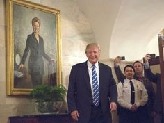 PHOTO: President Donald Trump greets the first new visitors in the Center Hall of the Ground Floor of the White House, in front of the official portrait of former first lady Hillary Clinton, Washington, March 7, 2017.