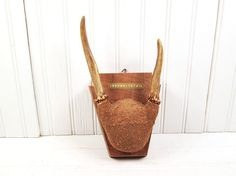 Vintage deer antler wall rack.