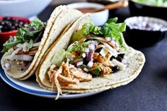 Crockpot Cheddar Beer Chicken Tacos. Easy and pretty good when served with all the fixin's. Be sure to use a dark beer for best flavor. Yum!