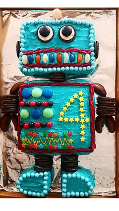 I made this robot cake for my 4 year old boys Birthday. It was chocolate mud with butter icing.