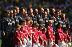 The New Zealand cricket team stand for the national anthem during the 2015 ICC Cricket World Cup final match between Australia and New Zealand at Melbourne Cricket Ground on March 2015 in Melbourne, Australia. Icc Cricket, Cricket World Cup, World Cup Final, National Anthem, New Zealand, Finals, Photo Galleries, News, Sports