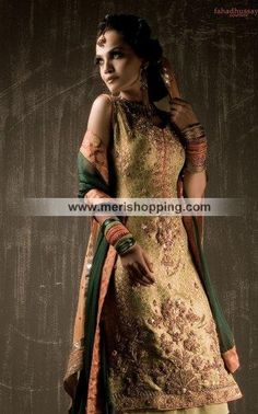 A Tradiitional Gold And Green Heavy Shalwar Kameez Gold Traditional ShalwarKameez Item# 1372 $289