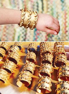 diy cute bracelet made of toilet paper rolls, mac. and spray paint. I would use this same concept nd maybe do a design with a glue gun then spray paint it for a costume piece. DIY Egyptian costume jewelry for girl scout world thinking day