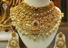 22 carat gold peacock design bridal pacchi work polki diamond choker adorned with rubies, emeralds and south sea pearls. Wedding Jewellery Designs, Gold Jewellery Design, Diy Jewellery, Latest Jewellery, Bridal Jewellery, Jewellery Storage, Wedding Jewelry, Indian Bridal Jewelry Sets, Bridal Jewelry Vintage