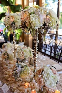 Silver candelabras are decorated with an abundance of flowers