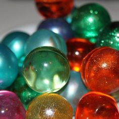 Bath Oil Beads...  I didn't like these in baths, but I loved the way they looked and how they were slightly squishy if you gently squeezed them--just don't squeeze too hard.  x_x