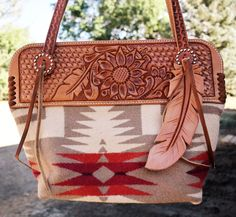 Gorgeous love the leather feather. southwest aztec handbag with leather tooling flowers and feathers Cheap Purses, Cute Purses, Purses For Sale, Leather Purses On Sale, Soft Leather Handbags, Tooled Leather Purse, Leather Bags, Leather Carving, Tote Handbags