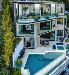 The home has three stories, each with its own set of balconies.